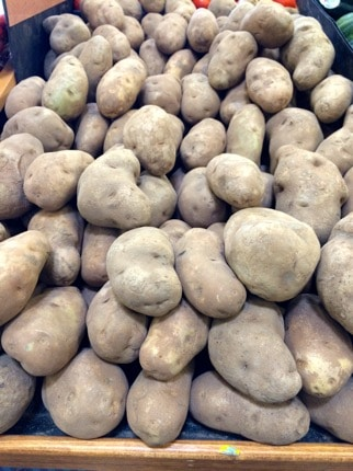 Pile of potatoes at the grocery store