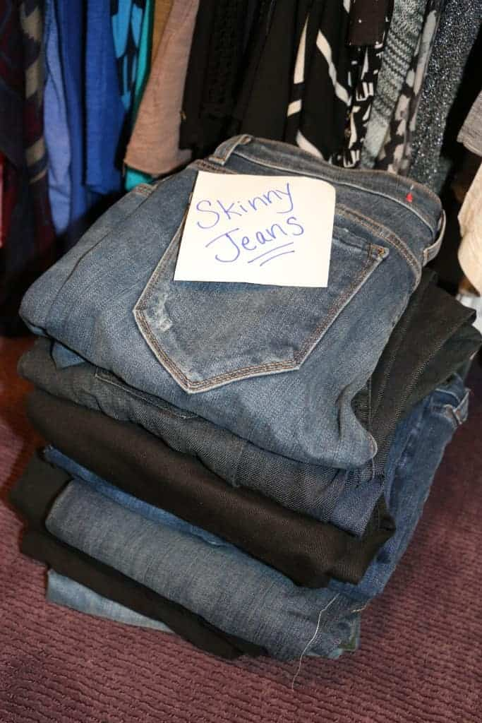 Pile of skinny jeans in a closet