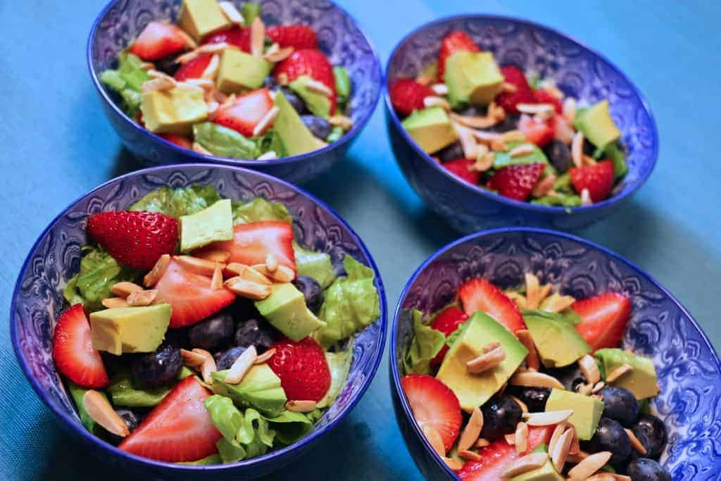 4 Super Vegan Summer Salads in blue bowls