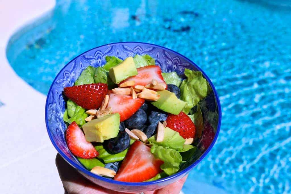 Super Vegan Summer Salad with a pool in the background