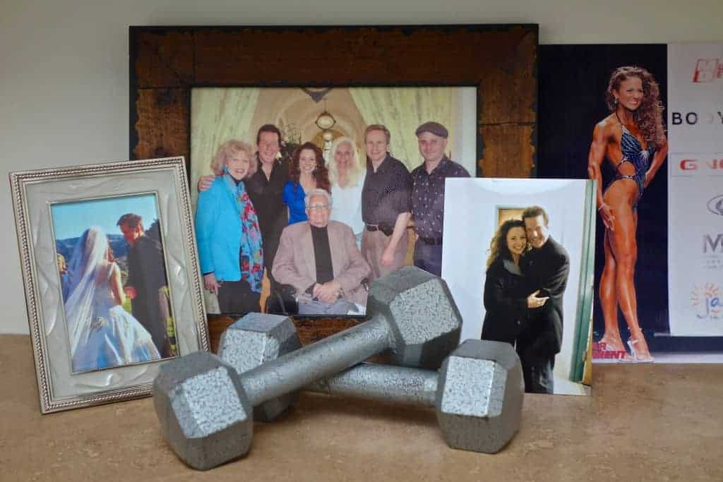 Hand weights in front of Dunham family photos