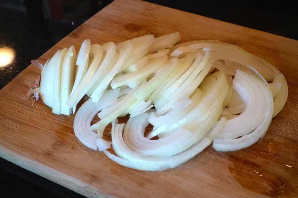 Onion cut up on a cutting board
