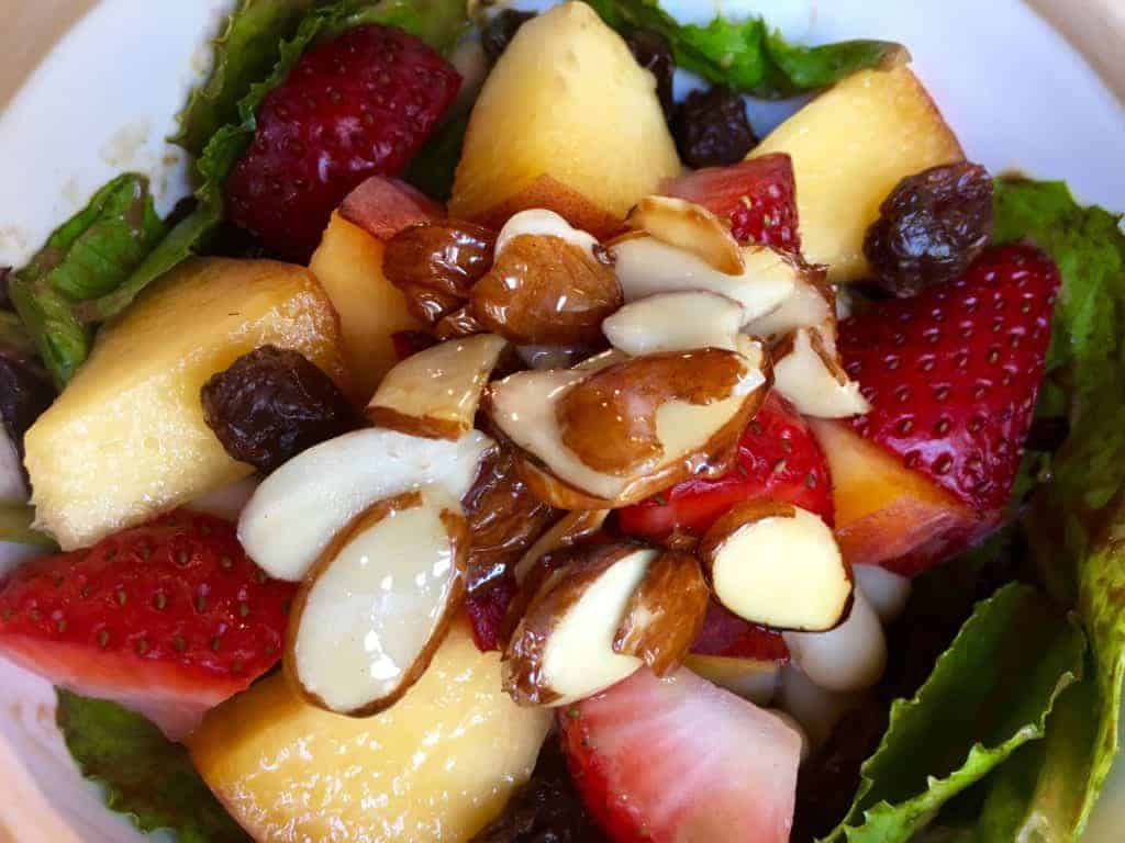 Strawberry Peach Salad with Glazed Almonds in a bowl