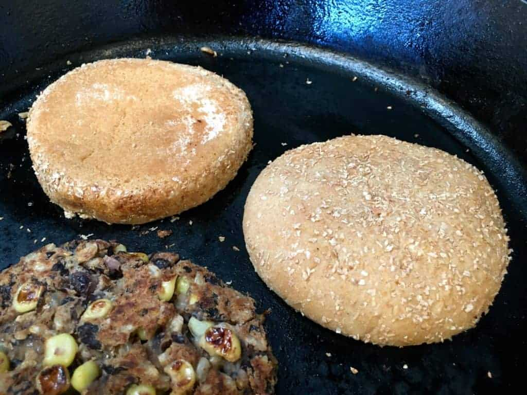 Burger buns toasting on the skillet