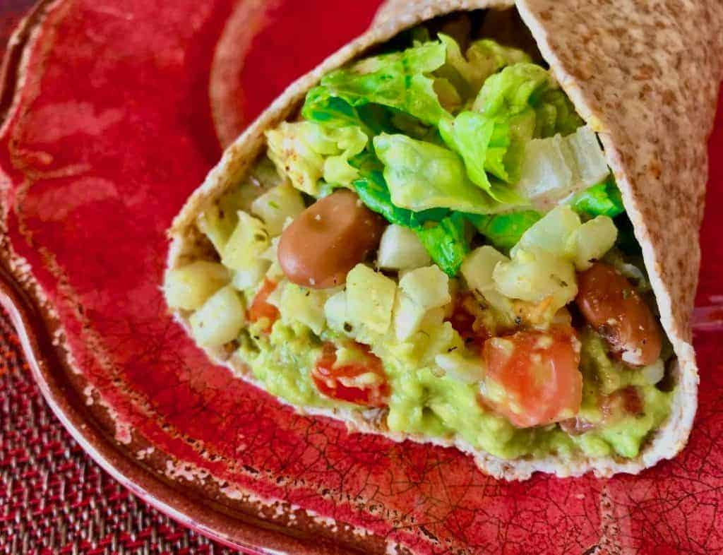 "Chipotle ""Cauliflower Rice"" and Guacamole Burrito on a red plate"
