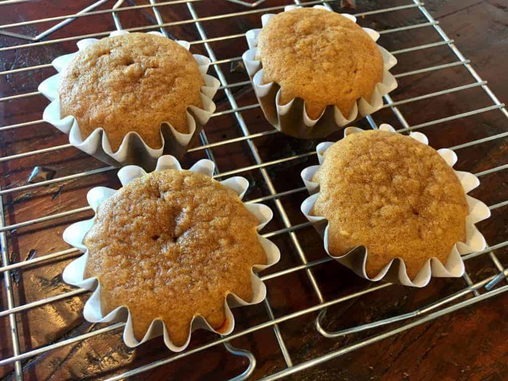 Baked pumpkin cupcakes on a cooling rack