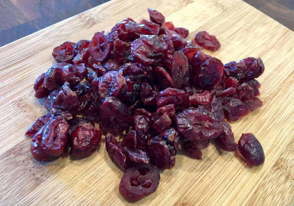 Pile of cranberries on a cutting board