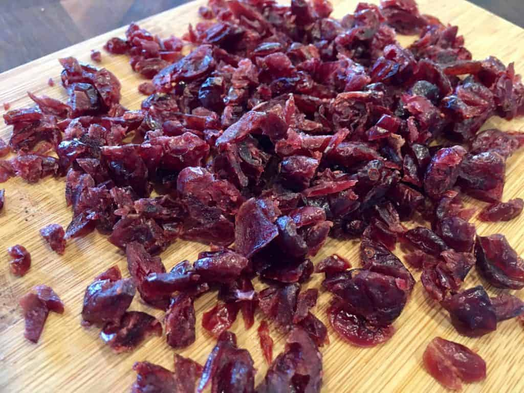 Chopped cranberries on a cutting board