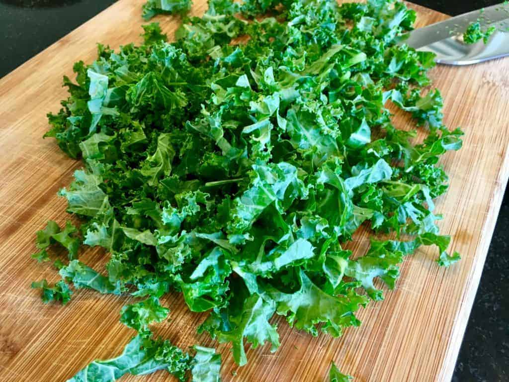 Chopped up kale on a cutting board