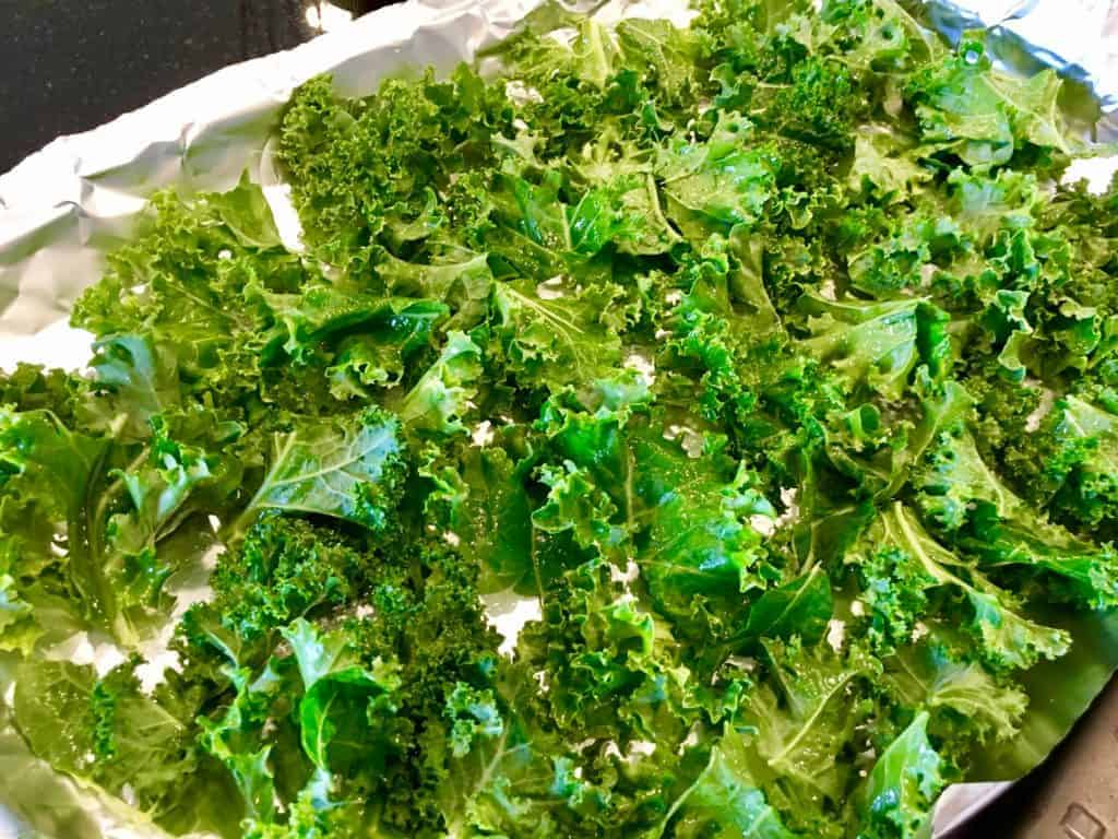 Kale spread out on a baking sheet