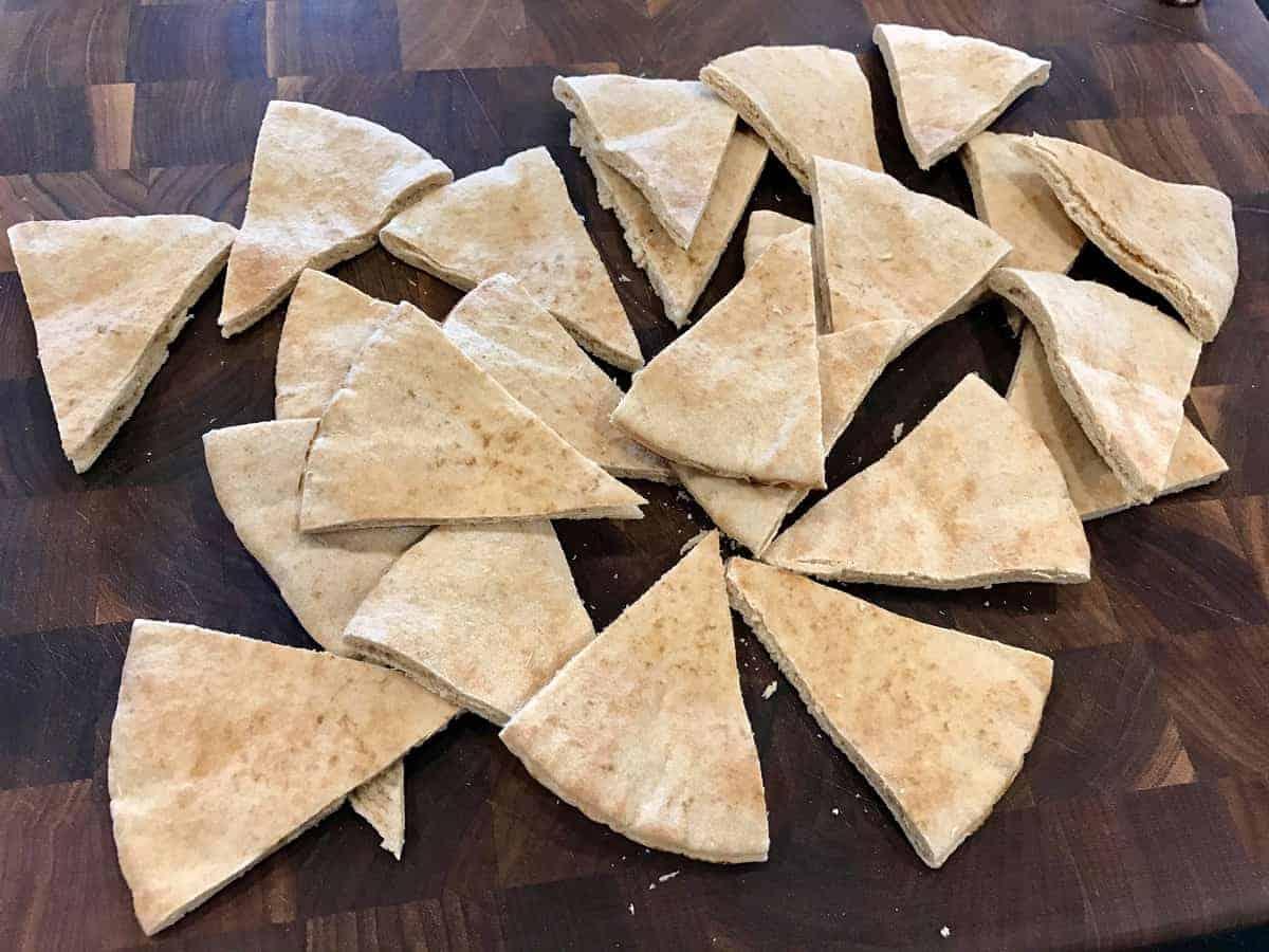 Cut up pita bread in triangles