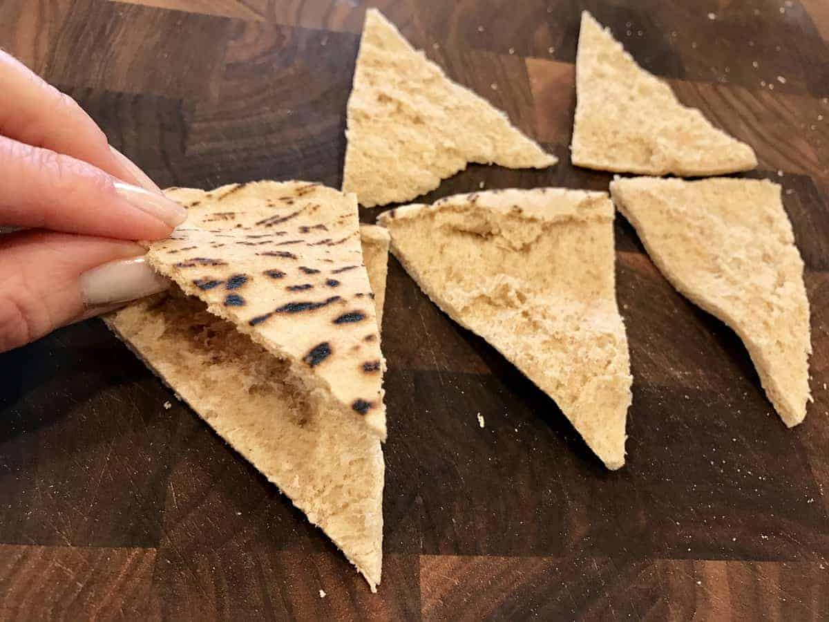 Pita triangles being separated
