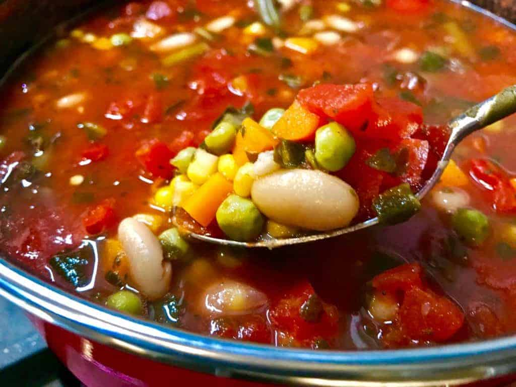 No-chop chunky vegetable soup in a pot with a spoonful