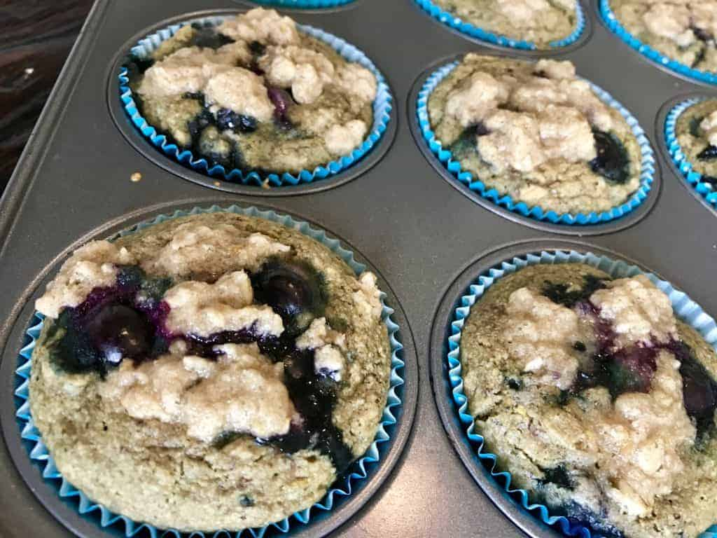 Baked lemon and blueberry muffins right out of the oven in muffin tin