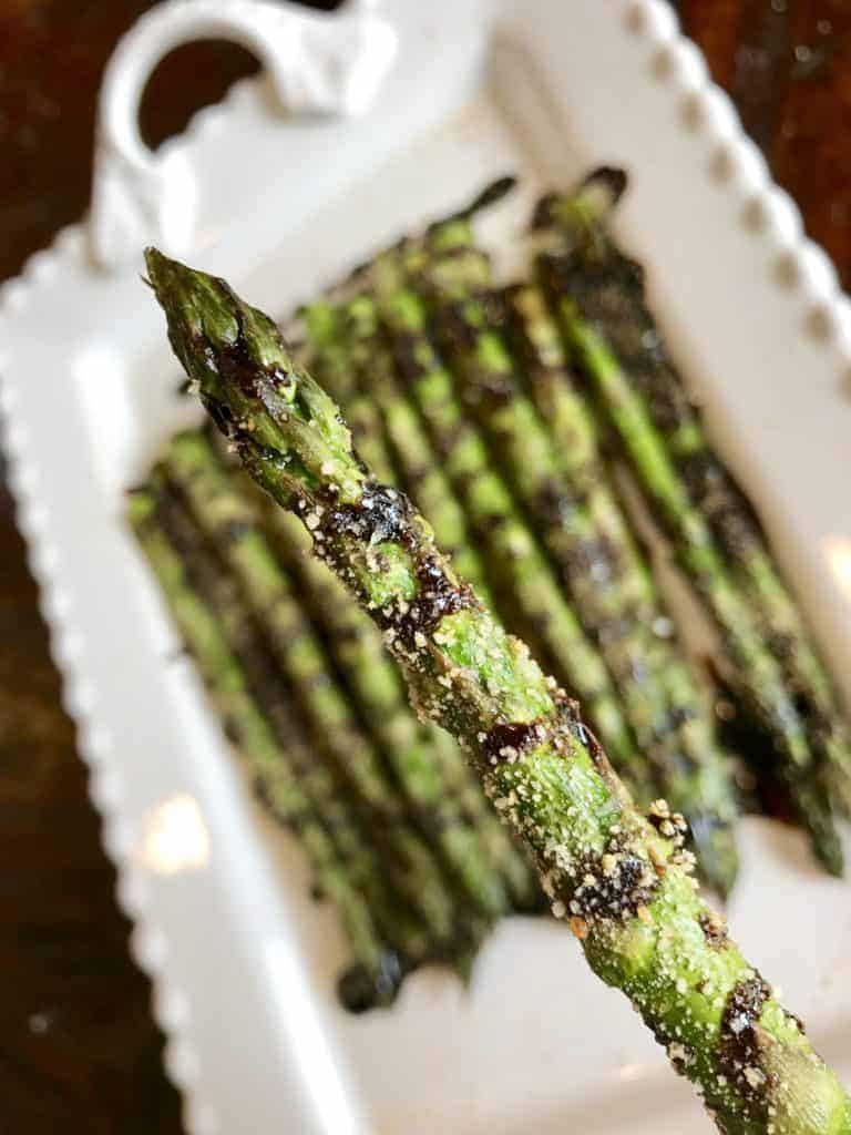 Close up of a piece of Roasted Asparagus with Balsamic Glaze