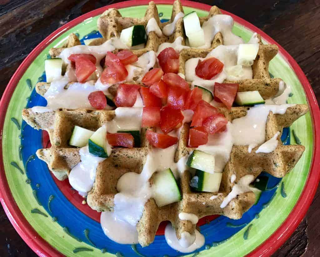 Vegan Savory Falafel Waffles with Tahini Sauce on a plate