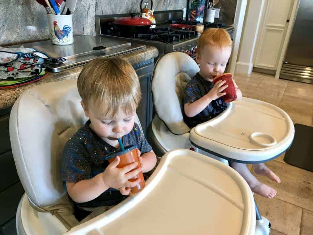 Jack and James enjoying Purple Snack Shakes in their high chairs