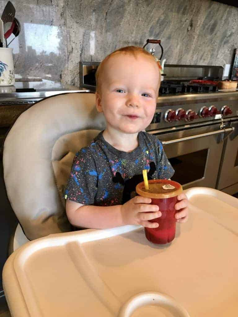 Jack enjoying a Purple Snack Shakes in his high chair