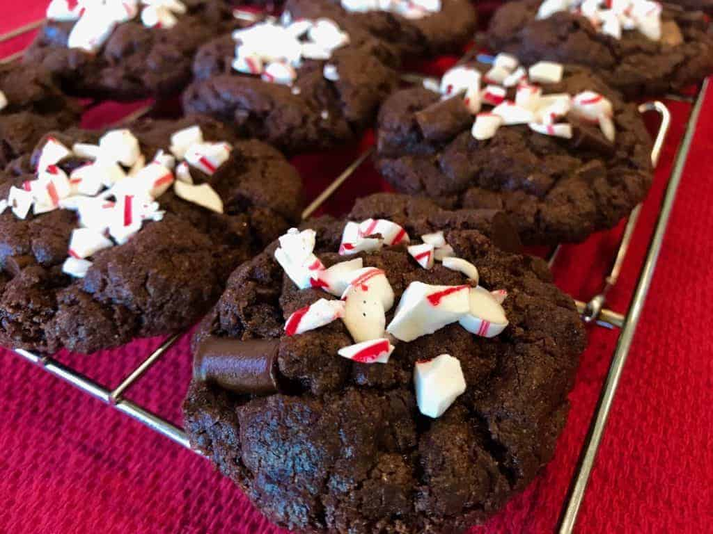 Up close photo of peppermint brownie cookies with chopped candy can on top.