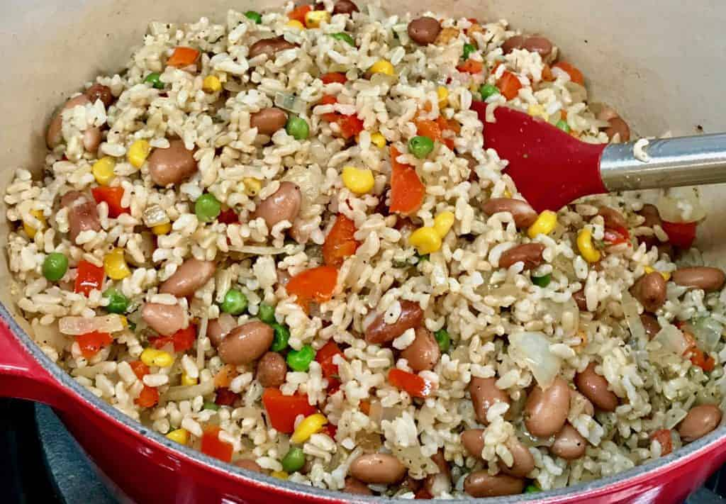 Beans, rice, and vegetables mixed together in a pot