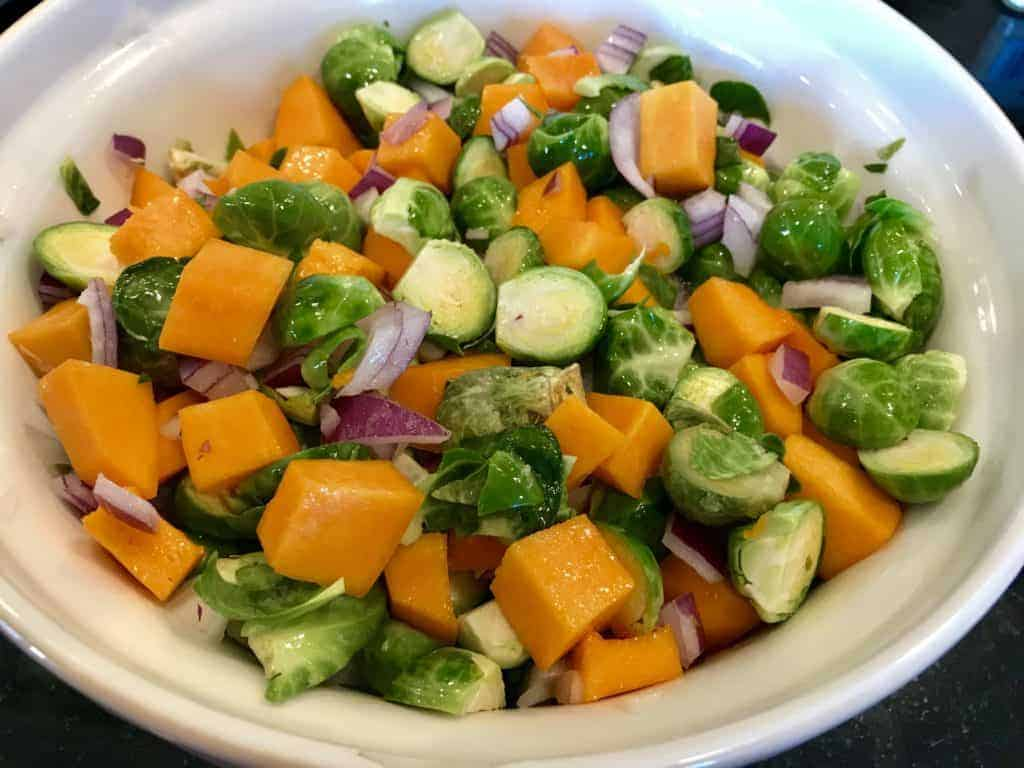 Roasted vegetables in a mixing bowl