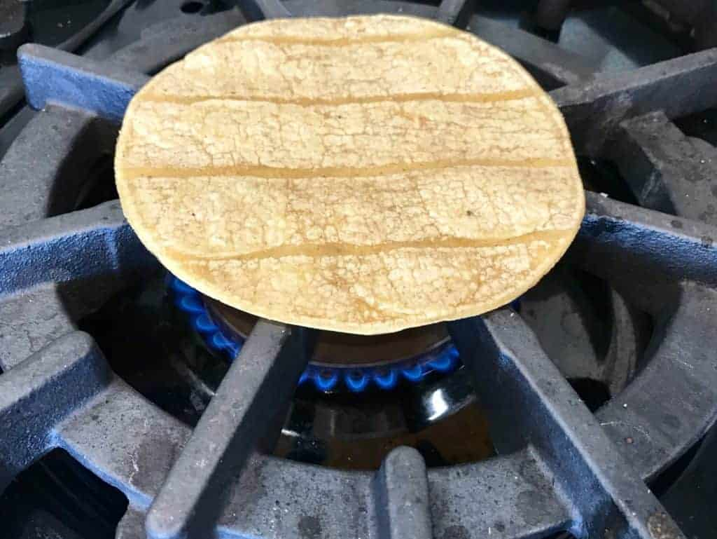 Warming up tortilla on the stove