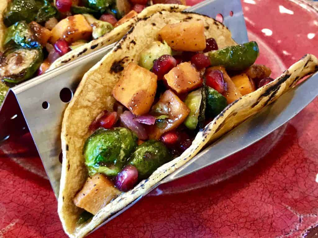 Roasted vegetable taco on a plate in a taco rack