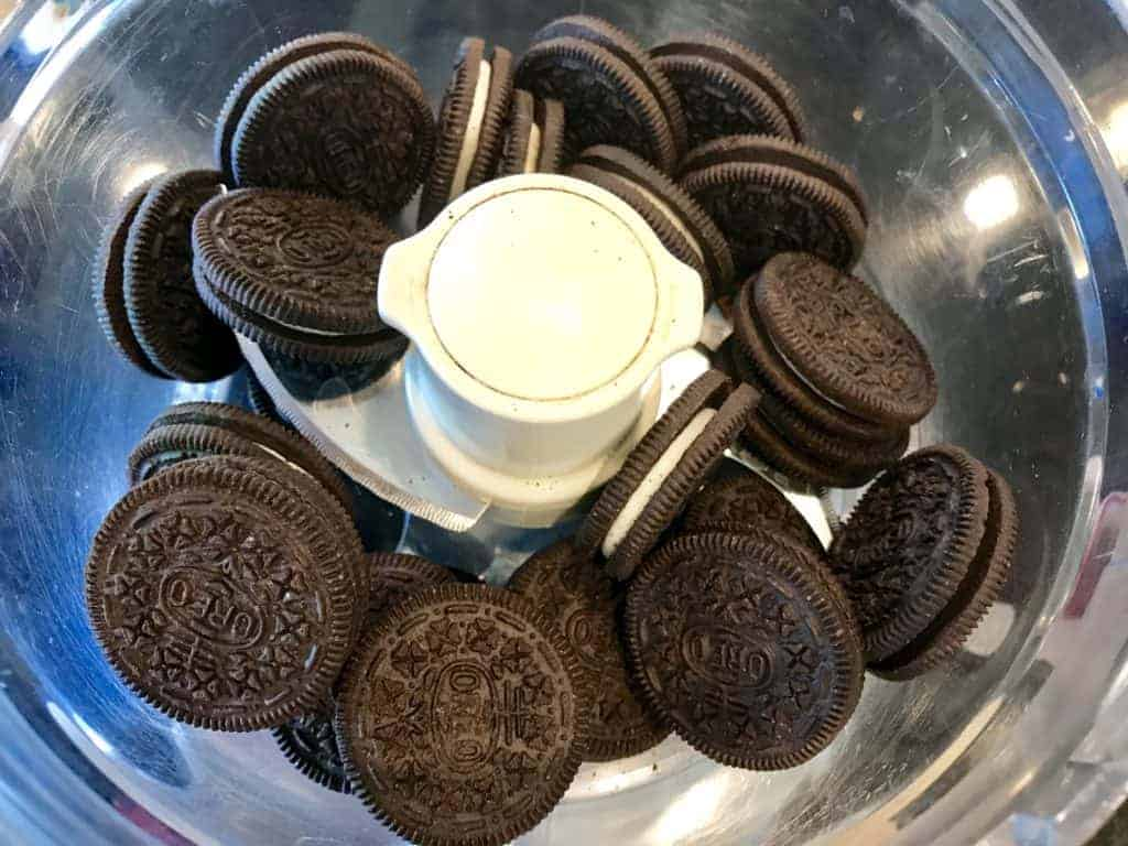 Oreo cookies and melted non-dairy butter in a food processor
