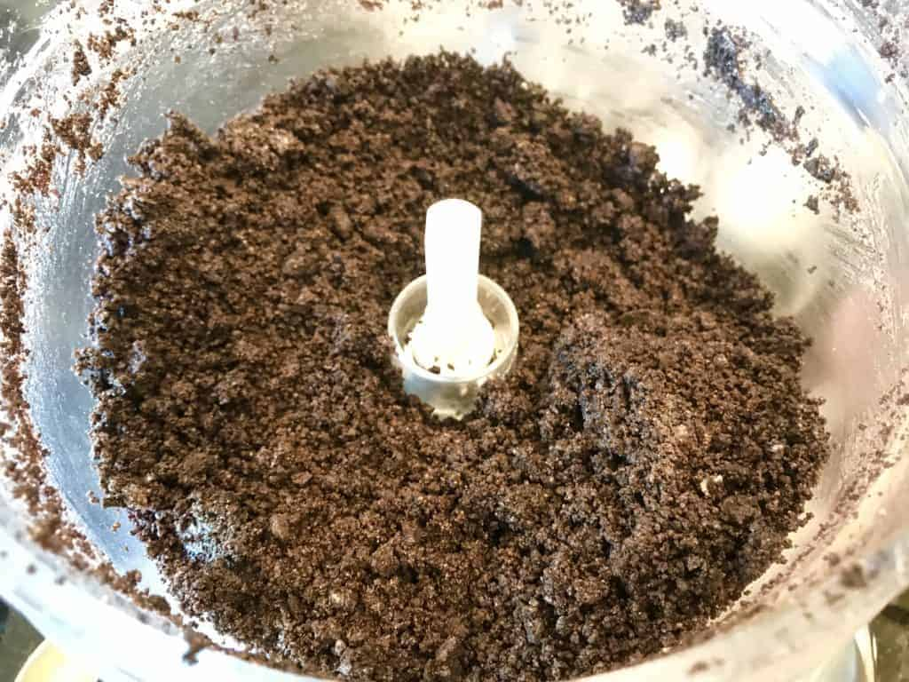Crushed up Thin Mints and non-dairy butter in a food processor