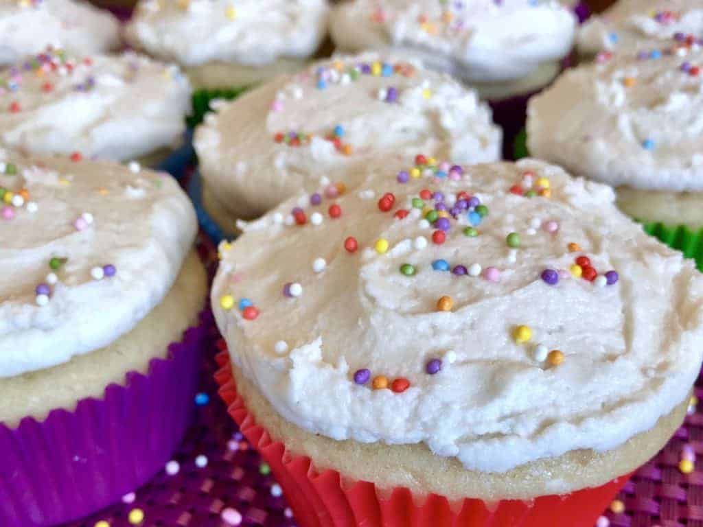 Close up Perfectly Vanilla Vegan Cupcakes with sprinkles