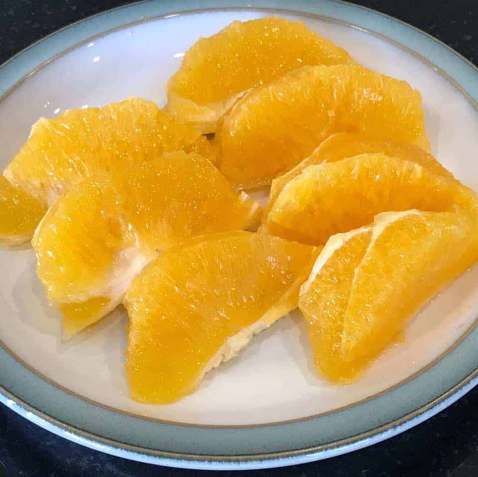 Cut up orange slices on a plate