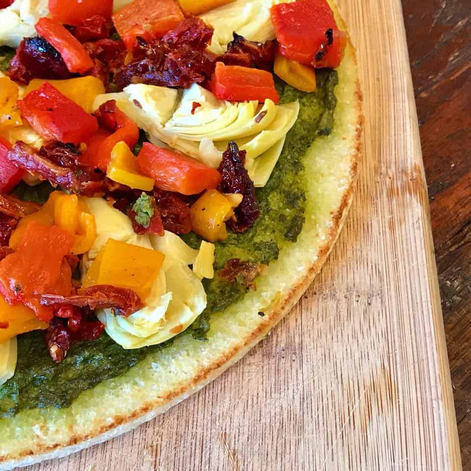 Close up of assembled roasted veggie pizza