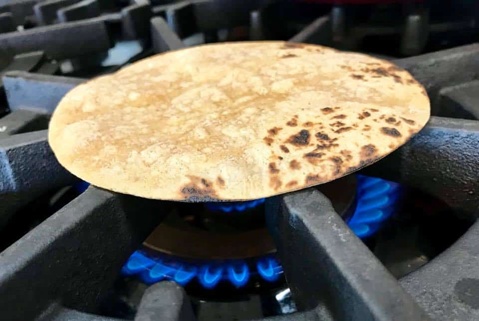 Warming a tortilla right on the stove top
