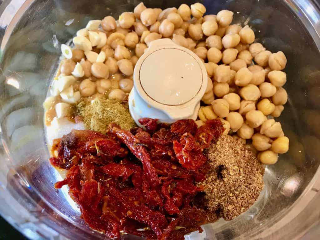 Sun-Dried Tomato Hummus ingredients in a food processor