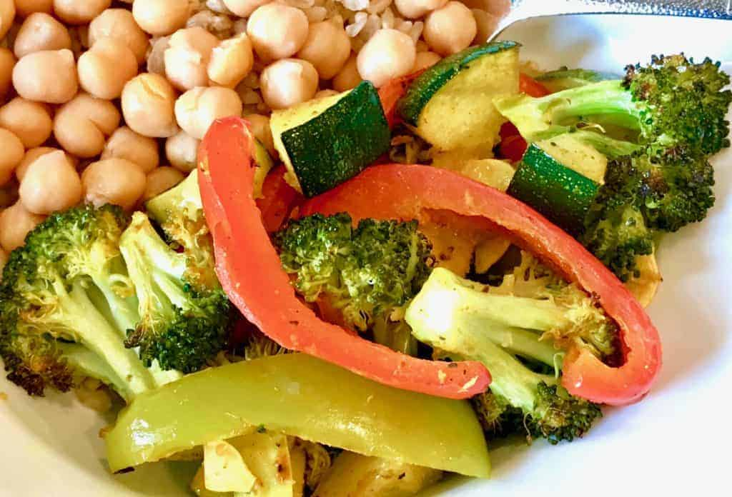 Easy Roasted Coconut Curry Vegetables in a bowl with rice and chickpeas