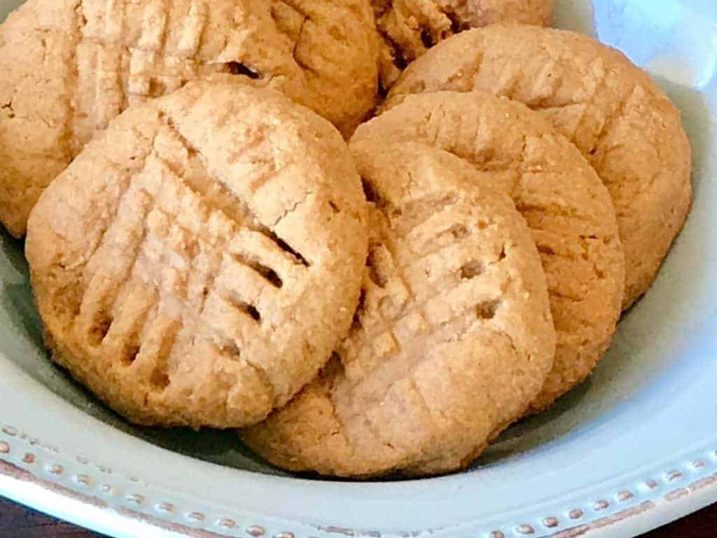 Baked peanut butter cookies in a bowl on a table