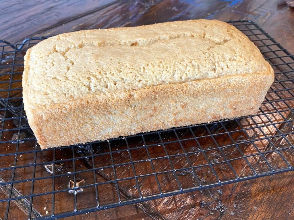 A baked pound cake with trimmed edges and corners.