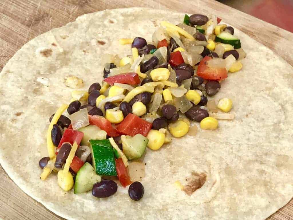 Vegetable and bean mixture atop a flat tortilla
