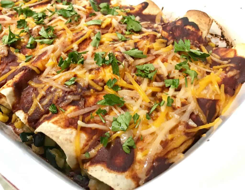 Baked enchiladas with parsley on top