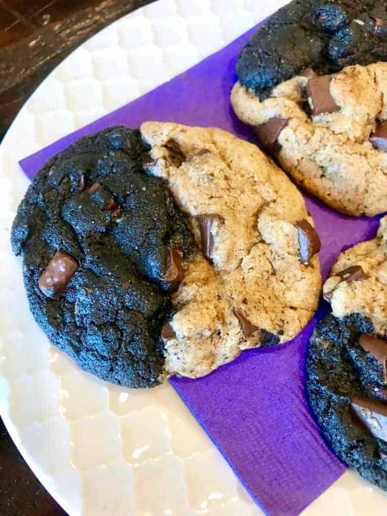Black n' white vegan chocolate chunk cookies on a plate