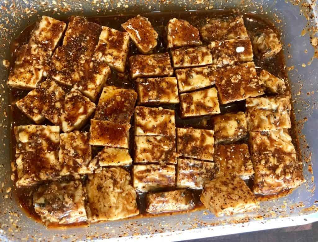 Cubed tempeh in a marinade