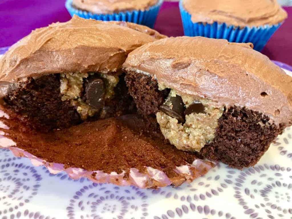 Vegan and gluten free cookie dough filled cupcake cut in half