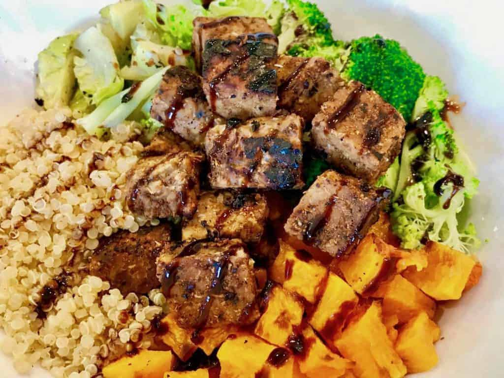 Sweet Chili Marinated Tempeh in a bowl with vegetables and quinoa