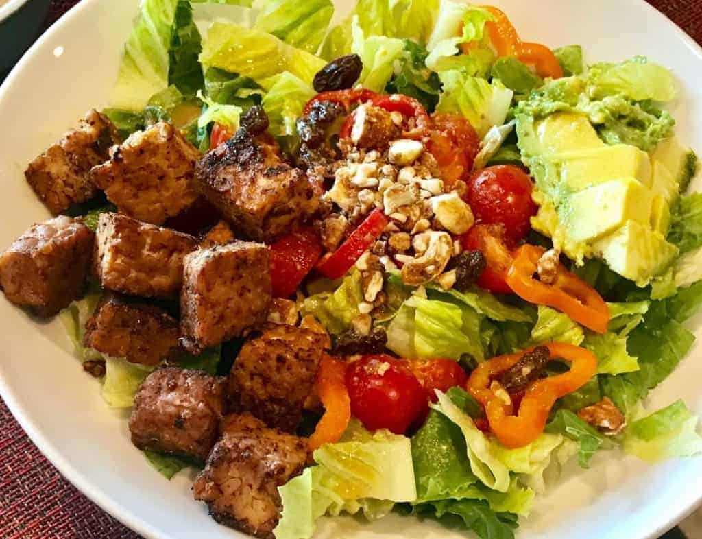 Sweet chili marinated tempeh on a salad