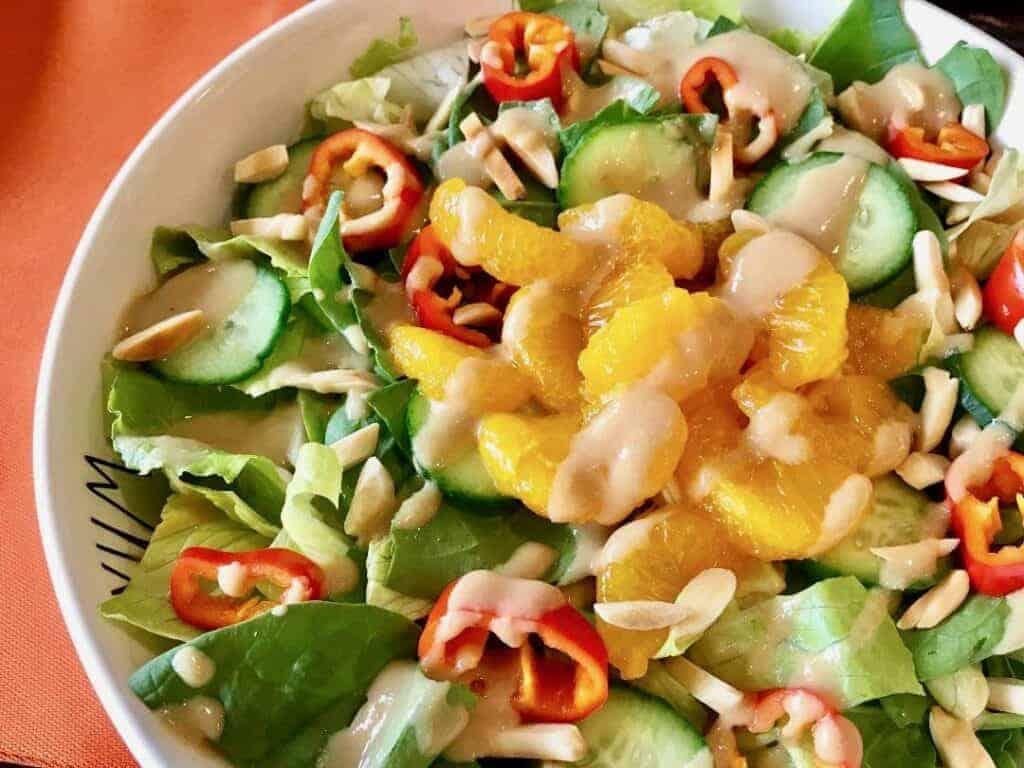 Close up of Sesame Ginger Dressing on a salad