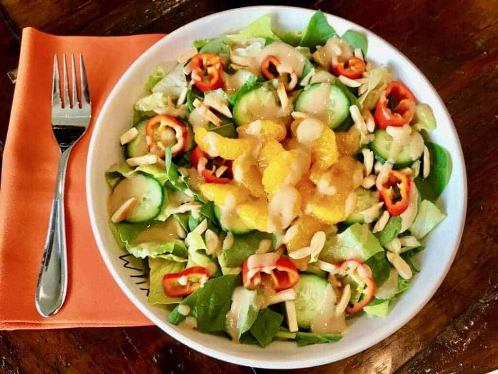 Sesame Ginger Dressing on a salad with a fork