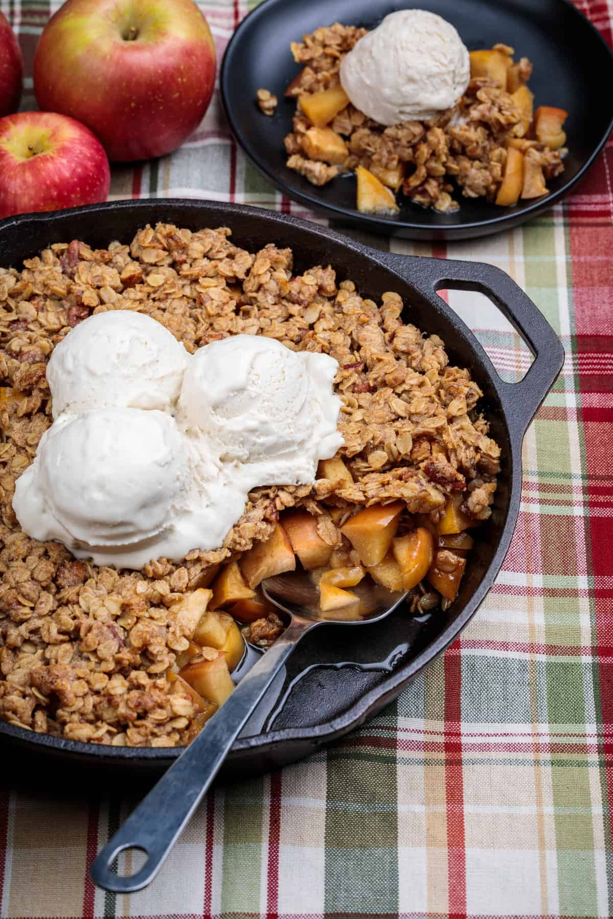 Skillet apple crisp topped with ice cream