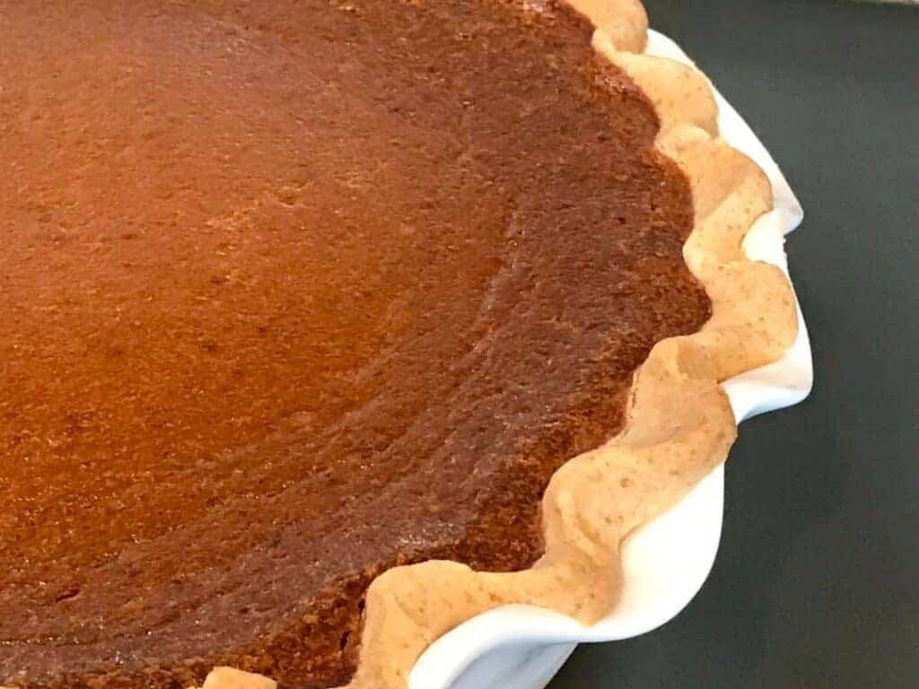 An unclose view of the pie crust when used in a pumpkin pie