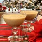Two cups full of vegan egg nog on a table