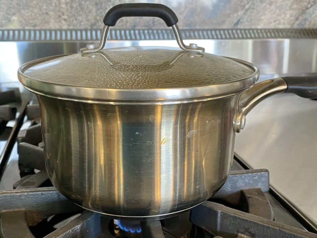 Covering boiling mixture with a pot